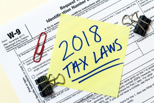 2018 Tax Laws written on sticky note