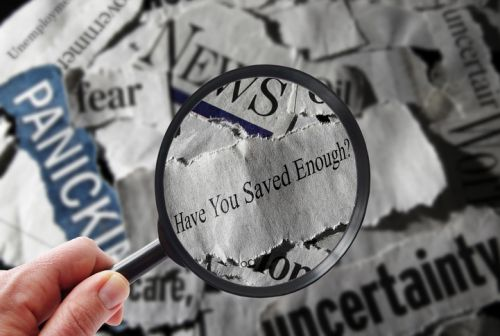 Retirement Milestones - Magnifying glass on newspaper -