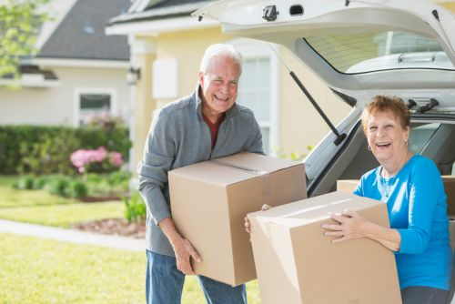 Senior Couple with Moving Boxes - Downsizing
