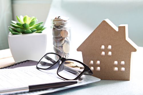 Coins, House Model and Papers representing Tax Basis and Your Estate Plan