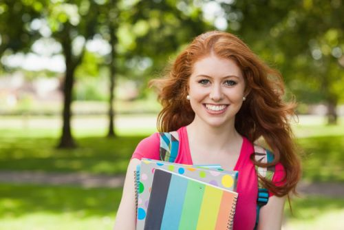 Photo of girl going to college with notebooks
