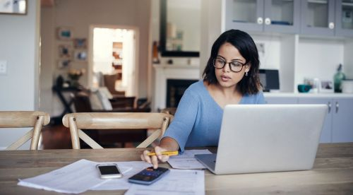 Young Adult with Laptop Working on Estate Planning