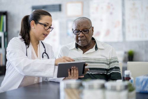 Doctor is explaining a medication schedule to patient.
