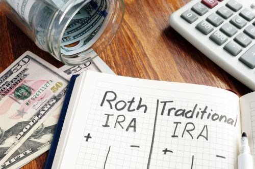 Roth IRA vs Traditional IRA written on a notepad.