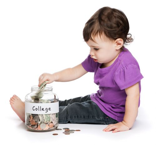 Baby putting money in a college savings jar.