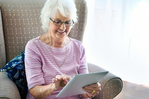 Grandma with iPad illustrating tech for seniors