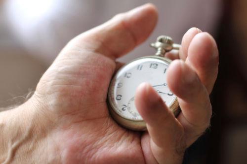 Senior man's hand with antique watch